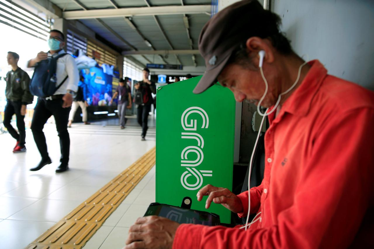 Indonesia`s Anti-trust Watchdog Levies $3 mln in Fines on Grab and Partner